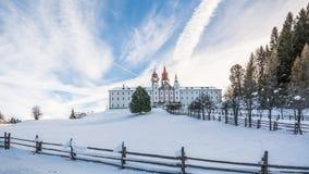 Monastery of Pietralba near Monte San Pietro, Nova Ponente, South Tyrol, Italy. The most important sanctuary of South Tyrol. Winte. R view with snow royalty free stock photos