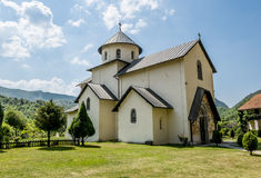 Monastery on the river Moraca amid mountains in the background. royalty free stock image