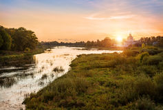 Monastery on the river. In the morning light of the sun Royalty Free Stock Photography