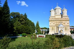 Monastery in Romania. The Cathedral of Curtea de Arges is a Romanian Orthodox cathedral, gardens, blue sky, colors, three, sightseeing, a trip to Romania Royalty Free Stock Photos