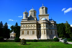 Monastery in Romania. The Cathedral of Curtea de Arges is a Romanian Orthodox cathedral, gardens, blue sky, colors, three, sightseeing, a trip to Romania Royalty Free Stock Image