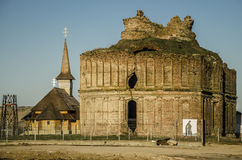 Monastery ruins and new church. The ruins of a historic monument, the Chiajna Monastery, in Giulesti district, Bucharest and the new church built near the old Royalty Free Stock Photography