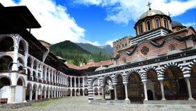 The Monastery of Saint Ivan of Rila, Rila Monastery. Panoramic view, famous Eastern Orthodox monastery, UNESCO heritage. Stock Photos