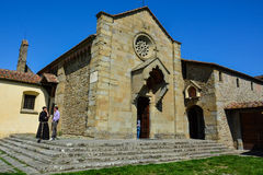 Monastery of San Francesco, Fiesole, Italy. A monk and a tourist talking in front of the old Monastery of San Francesco (Fiesole, Italy royalty free stock image
