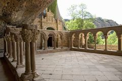 The Monastery of San Juan de la Pena, Jaca, in Jaca, Huesca, Spain, carved from stone under a great cliff.  It was originally buil Stock Image