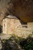 The Monastery of San Juan de la Pena, Jaca, in Jaca, Huesca, Spain, carved from stone under a great cliff.  It was originally buil Stock Images