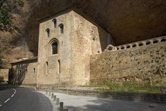 The Monastery of San Juan de la Pena, Jaca, in Jaca, Huesca, Spain, carved from stone under a great cliff.  It was originally buil Royalty Free Stock Photos