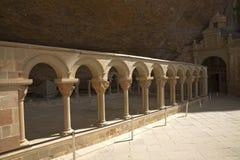 The Monastery of San Juan de la Pena, Jaca, in Jaca, in Jaca, Huesca, Spain, carved from stone under a great cliff.  It was origin Royalty Free Stock Image