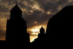 Monastery silhouette. Old medieval monastery silhouette against sunset sky Royalty Free Stock Image