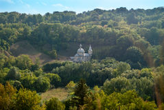 Monastery. Summer landscape forest around the monastery in the mountains Royalty Free Stock Photography