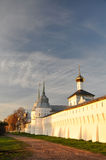 Monastery at sunset. Wall of female Orthodox monastery at sunset. Autumn stock photos