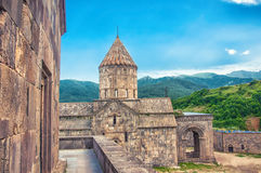 Monastery Tatev - Armenian Apostolic Monastery of the 9th century. Mountains, green hills and clear blue sky. Armenia Royalty Free Stock Image