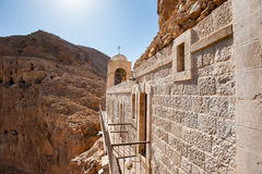 Monastery of the Temptation. The Greek Orthodox Monastery of the Temptation perches on a desert mountain cliff overlooking the West Bank town of Jericho stock images