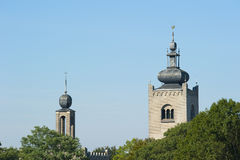 Monastery towers above tree tops Royalty Free Stock Photos