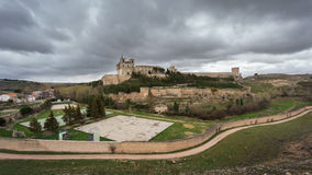 Monastery at Ucles, Castilla la Mancha, Spain. cloudy sky Royalty Free Stock Images