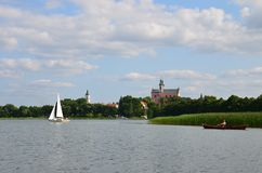 Monastery view from a boat - lake and forest at sunny day stock image