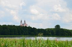 Monastery view from a boat - lake and forest at sunny day royalty free stock photos