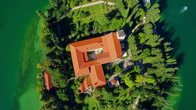 Monastery Visovac, aerial descenting shot Royalty Free Stock Photography