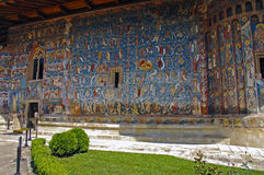 The Monastery Voronet. Details of painted exterior walls. Dominant color is well known blue of Voronet Stock Photo