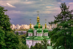 Monastery Vydubitsky. The Dnieper River and new buildings in Kiev Stock Images