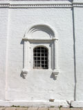 Monastery window. Whitewashed old stone wall with small window Stock Images