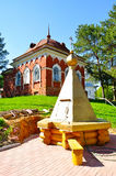 Monastery wooden well and building of red brick, built in the 19th century to the cells of the monks hermits on the territory of P. Monastery wooden well and Royalty Free Stock Images