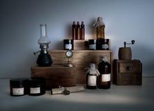Monasterypharmacy. bottles, jars, a kerosene lamp on wooden shelves Royalty Free Stock Image