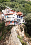 The monastic monastery located a ledge of Athos mountains. Royalty Free Stock Images