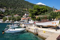 Monastiraki Fokida Harbour and Port, Greece. Small traditional wooden Greek fishing boats docked in the picturesque harbour and port, Monastiraki Fokida, or royalty free stock images