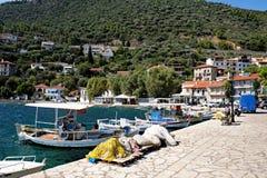 Monastiraki Fokida Harbour and Port, Greece. Small traditional wooden Greek fishing boats docked in the picturesque harbour and port, Monastiraki Fokida, or royalty free stock photography