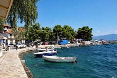 Monastiraki Fokida Harbour and Port, Greece. Small traditional wooden Greek fishing boats docked in the picturesque harbour and port, Monastiraki Fokida, or stock photography