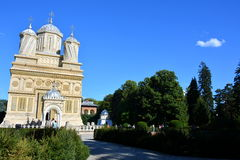 Monastyr in Romania. Monastyr of Curtea de Arges is a Romanian Orthodox cathedral, gardens, blue sky, colors, three, sightseeing, a trip to Romania, background Royalty Free Stock Photography
