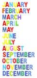 Monate gebildet durch hölzerne Alphabetfarbe Lizenzfreie Stockbilder