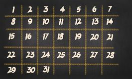 Monatskalender mit 31 Tagen auf Tafelhintergrund Lizenzfreie Stockfotografie