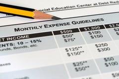 Monatsunkostenkorrekturlinien Stockfoto