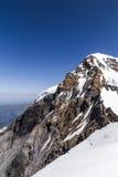 Monch峰顶在一清楚的天空天 库存图片