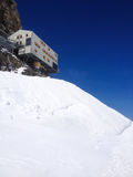 The Monchsjoch Hut Monchsjochhutte is situated in the middle of the Jungfrau-Aletsch UNESCO World Heritage. Jungfrau Region royalty free stock image