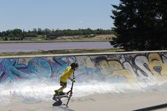 Moncton Skate Park. Child enjoying his time at the Moncton Skate Park. The Petticodiac River in the background Stock Photography
