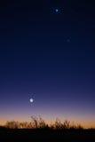 Mond, Jupiter, Venus und ein Komet Stockbilder