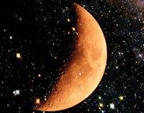 Mond und ein sternenklarer Himmel Stockfotografie