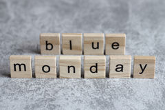 Monday blue word written on wood cube Stock Photo