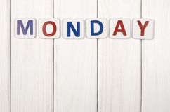Monday. Inscription on Monday against a white wood texture Royalty Free Stock Images