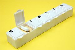 Monday meds. A medication dispenser opened for Monday Stock Photos