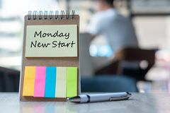 Monday New Start text on note paper or empty reminder template on wooden table. New Goal concept royalty free stock photo