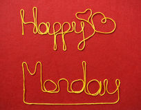 Monday ribbon greeting and hearts on red background Stock Images