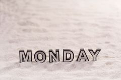 Monday word on white sand Royalty Free Stock Images