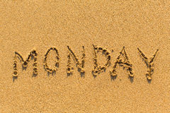 Monday - written by hand on a golden beach Royalty Free Stock Photos