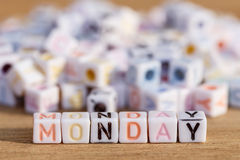 Monday written in letter beads on wood background Stock Image