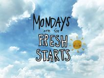 Mondays are for fresh starts word lettering and sun smile on blue sky