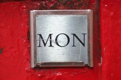 Mondays Post. Close up of a week day sign indicating pick up for post on a post box royalty free stock photos